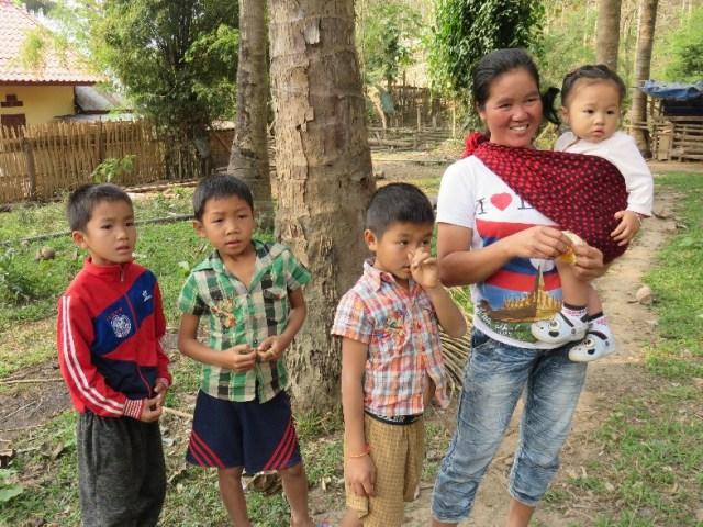 Female teak grower and family at Ban Densavang.